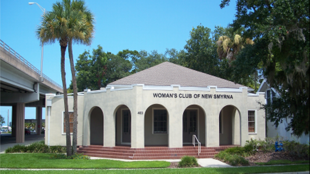 First Photo of Woman's Club, a single-story building with five archways framing the front entranc