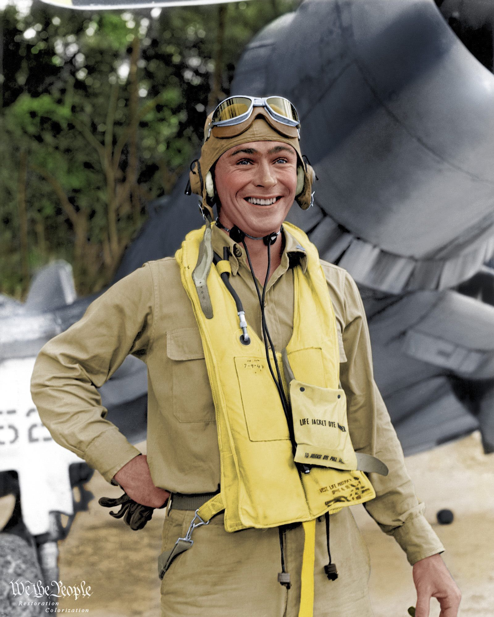 "Colorized photo of Lt. Col. John ""Jack"" Bolt at ease wearing a khaki flight uniform and yellow"